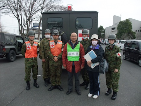 The author with a self defence team next to the exclusion zone, Minami-Soma City
